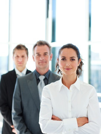 Friendly businesswoman in front of her team Stock Photo - 10250094