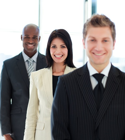 Beautiful businesswoman in focus with her team photo