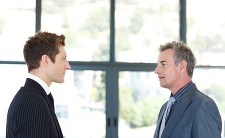 two face: Businessmen talking to each other
