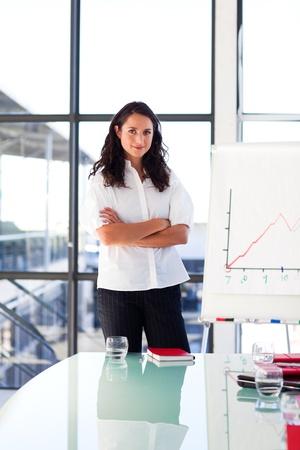 Confident brunette businesswoman in a presentation photo