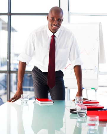 Handsome businessman after giving a presentation Stock Photo - 10246029