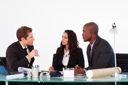 Three business people discussing in a meeting photo