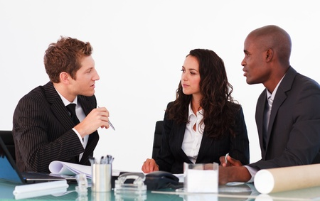 young office workers: Business people discussing in an office