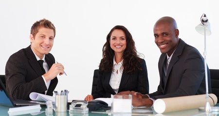 Business team in a meeting looking at the camera Stock Photo - 10246233