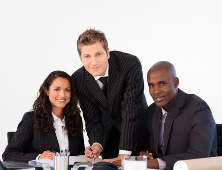 Business team in a meeting looking at the camera photo