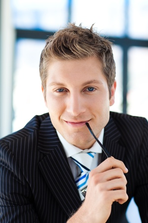 Portrait of a businessman with glasses photo