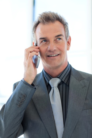 Senior businessman talking on phone Stock Photo - 10248904