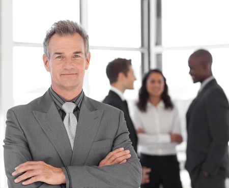 Senior Businessman with team in Background Stock Photo - 10250116