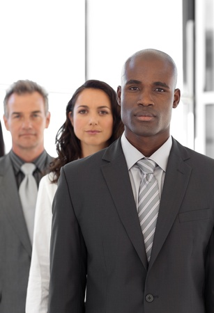 Serious ethnic business leader in front of team Stock Photo - 10249449