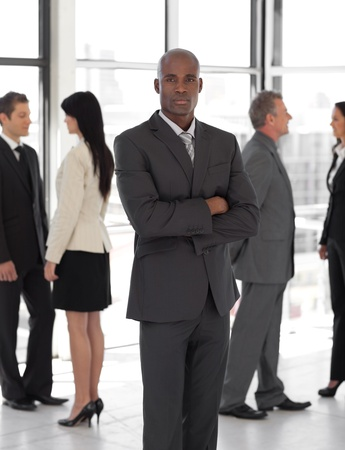 Business man looking at camera with group in background Stock Photo - 10247936