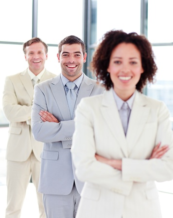 Smiling businessman with folded arms in a row Stock Photo - 10245990
