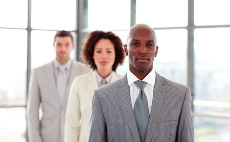 african american businesswoman: Serious African-American businessman leading his colleagues