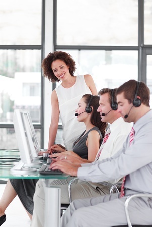 Leader managing her team in a call center photo