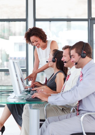 agents: Female leader managing he team in a call center