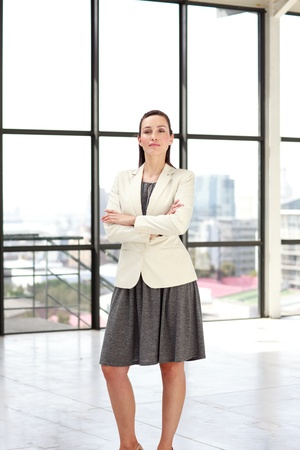 Serious businesswoman standing in an office photo