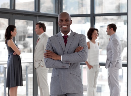 interacting: Afro-american male leader with his team