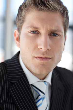 Young Attractive businessman looking at camera photo