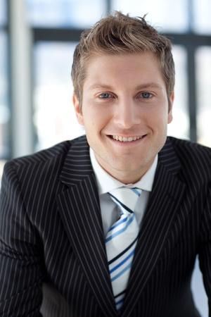 close portrait: Attractive Smiling Businessman Stock Photo