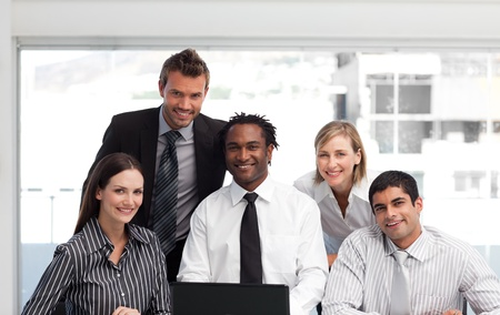 Business team working in an office looking at the camera photo