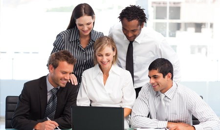 Business team working in an office photo