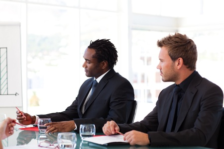 Businessmen sitting in a meeting photo