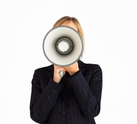 Closeup of a businesswoman with a megaphone hiding her face photo