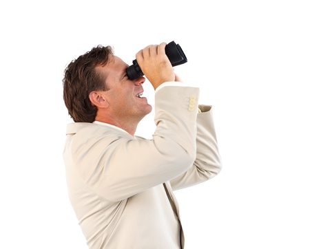 Handsome businessman manager searching for something with binoculars  photo