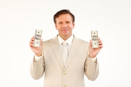 Handsome businessman holding money Stock Photo - 10250306