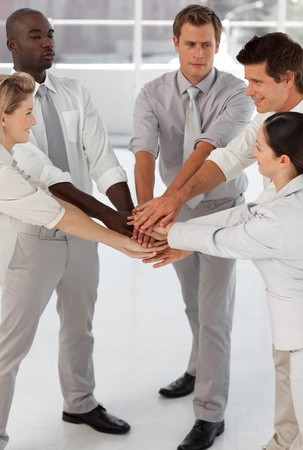 Close up of smiling business team with hands together in the office Stock Photo - 26719169