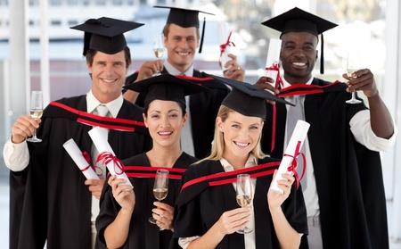 lernte: Gruppe von Personen Abschluss College Lizenzfreie Bilder