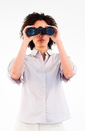 Young Afro-American businesswoman using binoculars photo