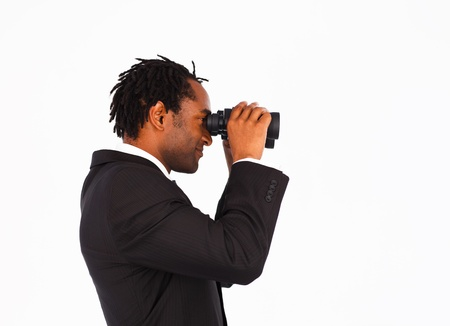 Sidewise closeup of a cute afro-american businessman with binoculars  photo