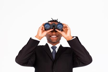 Handsome businessman holding binoculars upwards  photo