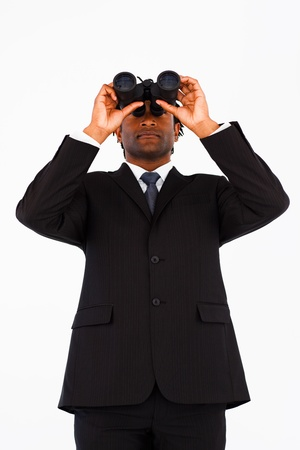 Serious afro-american businessman using bioculars  photo