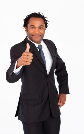 Attractive businessman showing thumb up photo