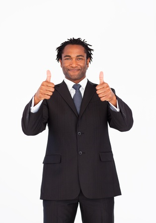 Handsome businessman with thumbs up photo
