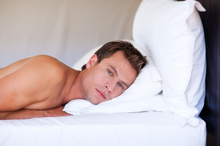 1 adult only: Attractive man relaxing on bed