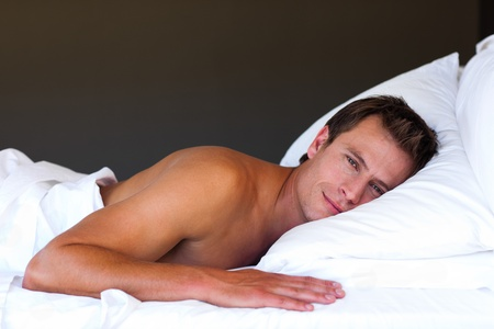 Handsome boy relaxing in bed Stock Photo - 10249810