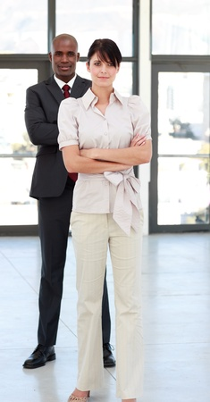 Business people with folded arms photo