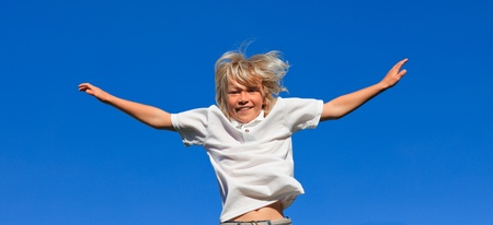 Young kid Jumping in the air photo
