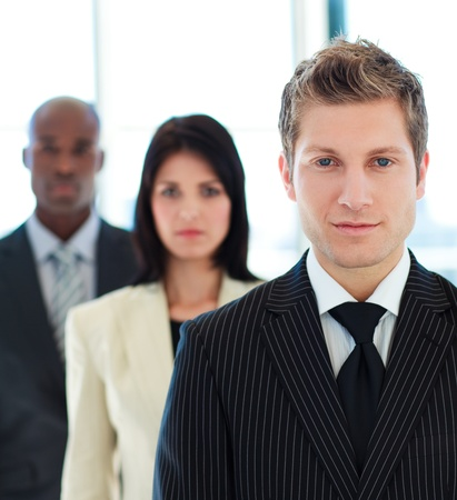 Portrait of a serious businessman in front of his team Stock Photo - 10250079