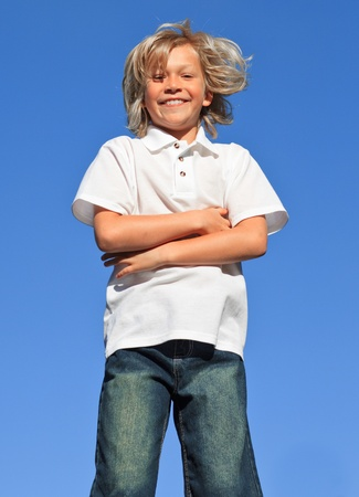 Young kid Jumping in the air Stock Photo - 10247337