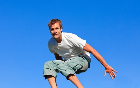 Young man jumping in the air photo