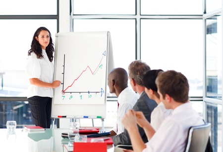 Businessswoman reporting to sales figures in a meeting Stock Photo - 10233917