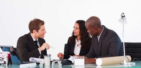 Business people interacting in a meeting photo