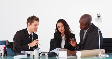 Business team talking to each other in a meeting Stock Photo - 10245965