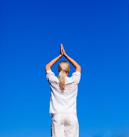 Blond woman practising yoga  photo