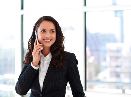 hand holding phone: Smiling businesswoman talking on phone Stock Photo
