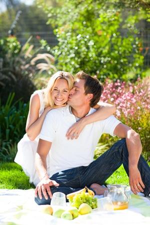 Cute couple enjoying a picnic photo