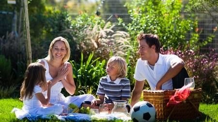 Happy family having a picnic photo